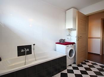 Fernwärme insgesamt verfliest - Moderne 3-Zi-Wohnung in Launsdorf