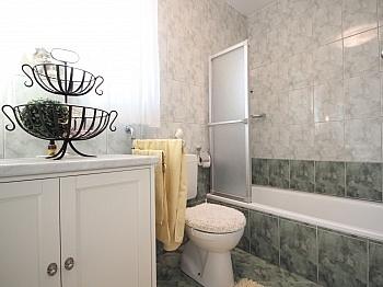 Schrankraum hauseigenem Maisonette - 2-Zi-Wohnung mit atemberaubendem Wörtherseeblick