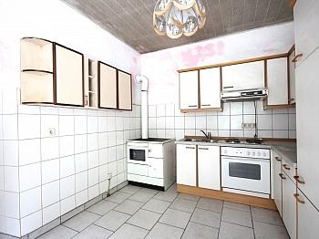 drei Dach voll - Idyllisches Mehrfamilienwohnhaus in Lölling