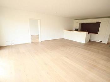 Ausgang großes Wohnbau - Tolle neue 133m² 4 Zi Gartenwohnung - 225m² Garten