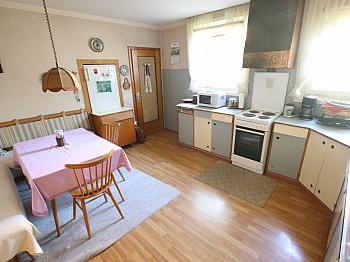 Gehminute absuluter jährlich - Wohnhaus mit 2 Wohnungen in Keutschach in SEENÄHE!